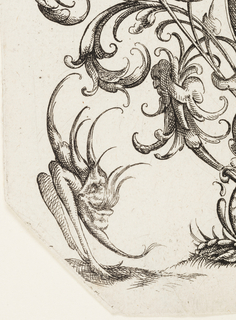 Two grotesque birds flank the vase from which the nosegay rises.