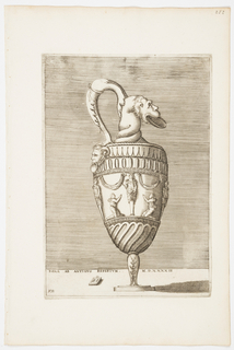 """Vertical rectangle. An ewer, whose handle is composed of an animal foot joining a grotesque head with twisted neck holding a dish in its mouth. On the body, two figures pay homage to a herm. Inscribed below: """"ROMAE AB ANTIQVO REPERTVM MD XXXXIII"""" and """"A.E.V."""" on a tablet."""