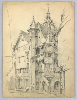 Tall house in elaborate 16th century style, late Gothic, with towers balconies and projecting window areas.