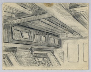 Room with corner in right background inside of hull of ship. Ceiling beams extend diagonally across top, wall on left side is leaning outward and has three pairs of windows.
