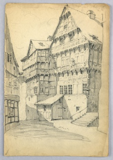 Five-story houses in half-timber and gable style found in French and German medieval villages.