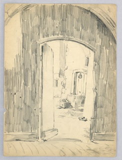 Doorway, wood inset in stone arch, with open door revealing courtyard in background, stone well, wall and pair wooden sabots.