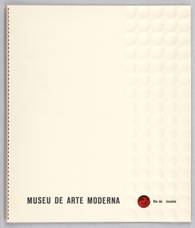 Spiral-bound booklet with embossed cover for Museu de Arte Moderna, Rio de Janeiro, Brazil. White cover with rows of embossed white circles at right side, one of which at bottom is cut out, revealing a portion of a black and red photoillustration near bottom, which highlights the site location of the new museum. In line with this circle, printed text with museum name and location. Inside pages contain printed text and photoillustrations (some showing museum construction), illustrated maps, floor plans, description of museum departments and programs, and a list of the board of directors and trustees.