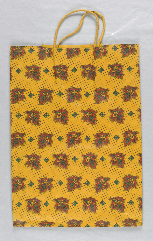 Stylized leaf pattern in brown and green on orange-yellow background.