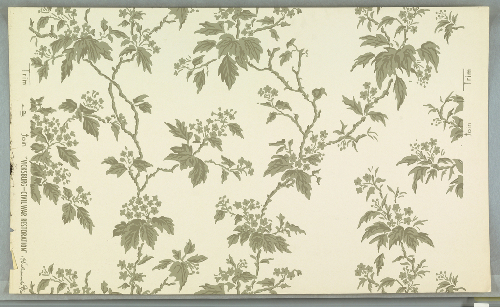 "On glossy white ground, pattern of meandering vines with clusters of tiny flowers, in two tones of gray. Printed in margin: ""...Vicksburg Civil War Restoration Scalamandre."""