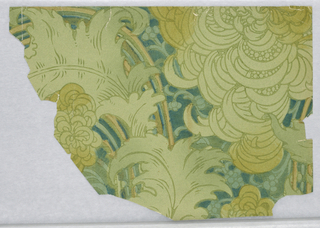 Portion of a paper with large-scale chrysanthemum flowers and foliage in scrolled arabesque, in neutral colors.  Printed in blues and greens.