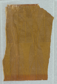 Art nouveau-styled design with repeating pattern of wheat shafts, printed in earth tones.