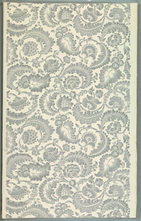 Closely set serpentine arrangement of flowers, leaves and stems. In the Indian style. Tones of gray on white ground. Reprinted from woodblocks of the 1820s.