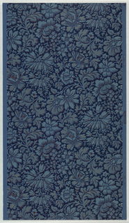 All-over floral pattern, printed in dark blue with red, light blue and gold accents. The flower is the blue ground color with the negative areas printed in dark blue. In the Aesthetic style.