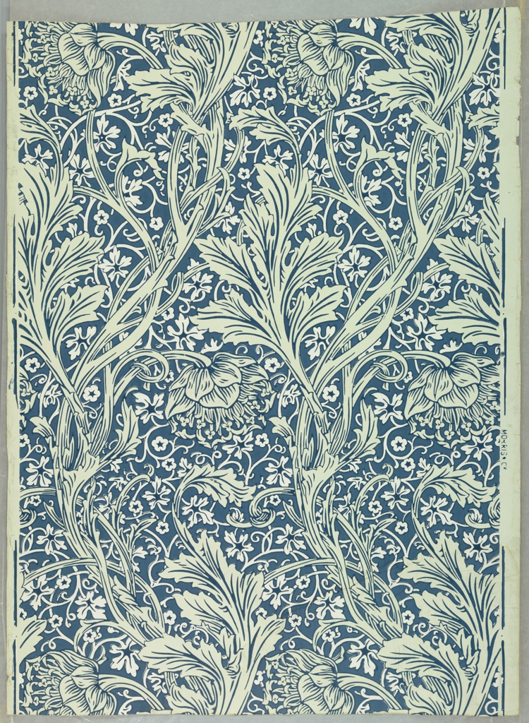 Repeat floral pattern of long leafed stems and blossoms in gray-blue on cream ground.