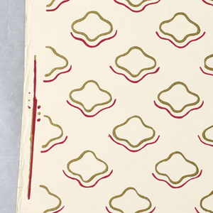 Drop-repeating series of gold-outlined motifs of roughly quatrefoil shape underlined with red lines following approximately the contours of the above. Printed on white ground.