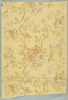 Floral pattern printed in pastel shades of blue, gray-green, orange-pink with metallic gold on cream ground