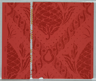 Faux damask or velvet pattern; upside-down stylized pineapples placed in the gaps of a diamond lattice pattern formed of horizontal hatching and alternating feathery leaves and sunburst motifs; stylized pear motifs at the intersections of the lattice; motifs have stencil effect; color scheme of dark red on red.