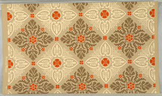 Beige quatrefoils of palmettes alternating with brown leafy quatrefoils, both with orange centers and orange scattered flowers on beige ground. Straight match and repeat.