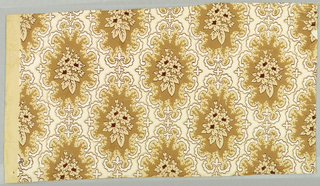 Series of diamond shaped medallions running diagonally, all alike. Center of each consists of a spray of three flowers and leaves, border is formed by a series of broken scrolls. Printed in tans and browns on beige colored glazed field.
