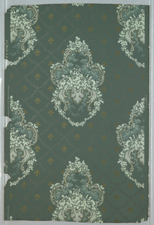 Drop-repeating design of rococo enframement or cartouche containing floral spray. The ground is sown with gold fleur-de-lis. Printed in colors and gold on dark blue embossed ground.