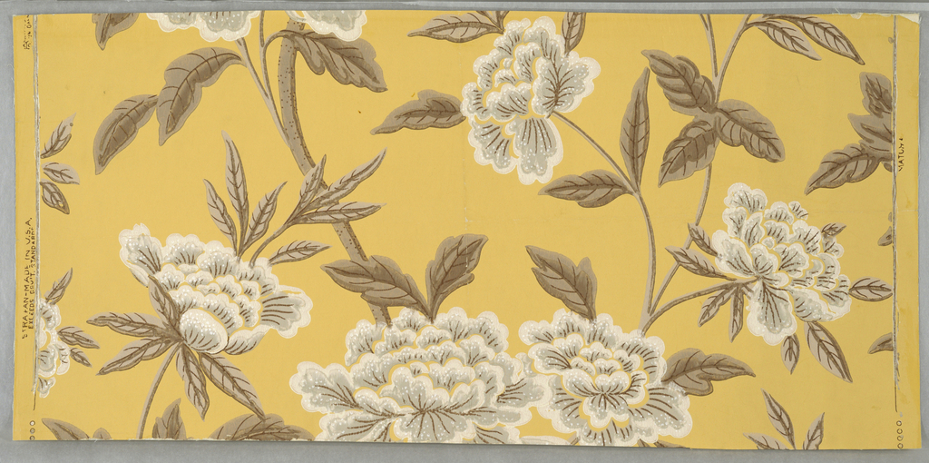 """Design of branching stems and large open flowers (peonies) and leaves. Printed in brown, gray and white on yellow ground. Marked on face: """"Strahan - Made in U.S.A."""""""