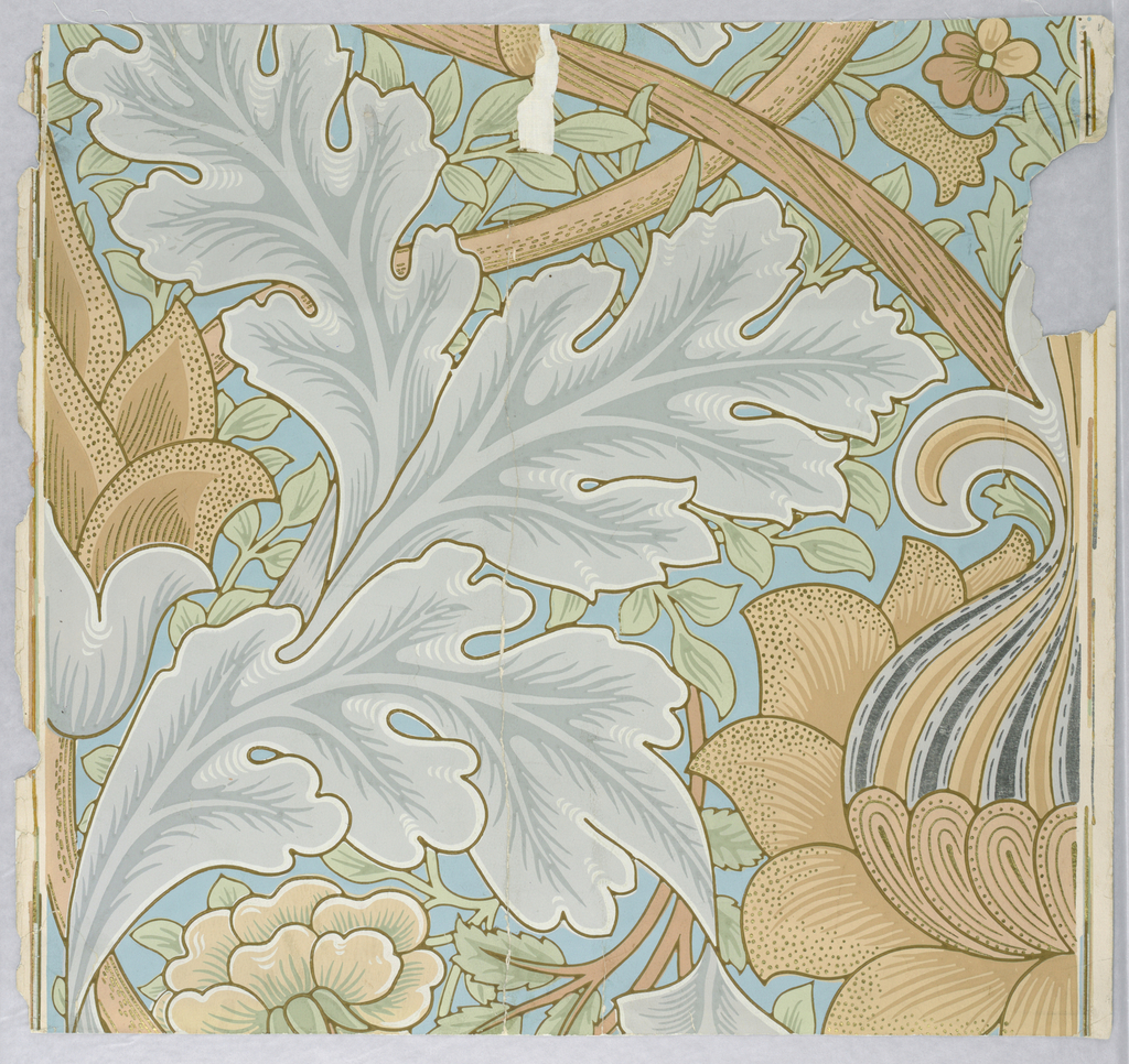 This paper used in St. James Palace, London, England. It requires two breadths of paper to show the complete repeat. The central motif is a large artichoke enwreathed in oak leaves, directly beneath is another motif, similar in design, but different coloring. At either end is a stylized pomegranate. A twisting vine runs through the design and small vines and leaves and flowers are scattered over the background. The original paper used in St. James Palace is printed on a red field. The design shows a Gothic influence. Used in Throne Room and the Wellington Room. Printed in gray, beige, green and tan on blue field. Portions are also in gold and silver.