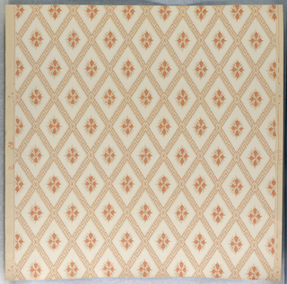 On gray ground diamond diaper design with outline of key pattern in salmon-pink.