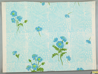 On white ground, blocks of blue with reserved linear fill pattern of foliage, scroll-work. Printed technique imitates woodcut. This overprinted in slightly transparent colors - sparsely scattered bright blue anemonies with green foliage.