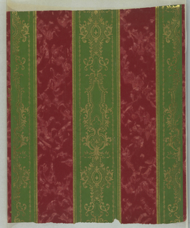 Green stripe with metallic gold scrollwork alternating with maroon stripe of ground color with effect of mottling.