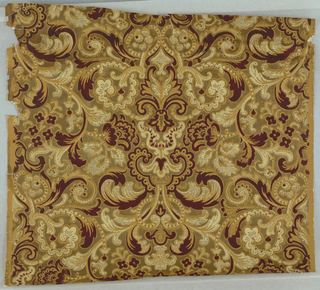 All-over design of floral and foliate scrolls. Printed in burgundy, ocher and white on embossed gold ground, resembling weave of textile.