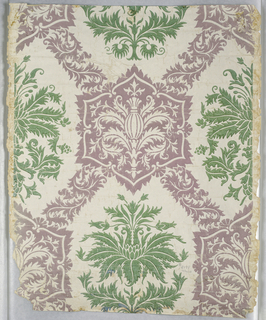 Stylized large damask pattern of green floral motifs alternating with hexagonal medallions of pineapples and foliage in lavender, linked by lavender foliage, against white background.