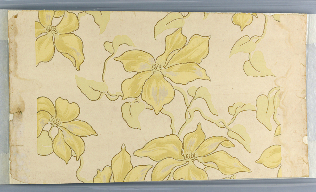 Floral motif, large scaled flowers with large petals in pastel chrome yellow and sage green, very delicate shades, on ivory field. Flowers and leaves outlined in gilt. No. 1939-33-46 is the border to this wall paper.