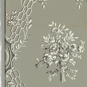 "Against a gray ground are printed widely spaced, diagonally running strips of openwork grill with twisting vines and blossoms. Diamond shaped areas formed by intersecting diagonals enclose a single bouquet of blossoms and foliage. Printed in dark gray and white. b) Same as ""a"" but larger sample."