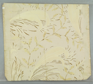An assymetrical leaf design with thin dashes of gold for highlights. The coloring is very delicate. Printed in ivory and gold on gray field.