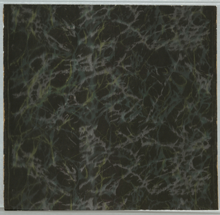 Green and lavender veining on black ground. A close, over-all pattern.