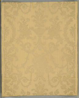 """Late 18th century French design. A symmetrical pattern composed of an urn with floriated foliage, with the usual festooned swags and acanthus leaf scrolls. The old ivory rayon flock design is on an embossed field which simulates a striped moire silk combined with a twill stripe - both narrow. Printed in right selvedge: """"Birge Made in U.S.A. 5302 U.W.C. of N.A. Union Made."""""""
