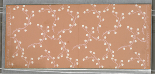 Design of curving stems with flowers scattered over ground. Printed in white and pale pink on deeper pink ground.
