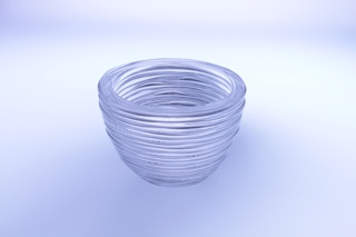 hemispherical bowl form with open base, and coiled ridges of glass