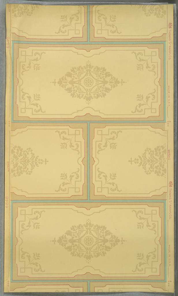 On cream ground, rectangular blocks arranged like bricks laid in bond. Outlined in pastel blue and pink with stylized central  and corner floral medallions in beige.