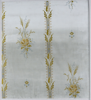 Pattern repeated in off-set vertical columns; two motifs repeated vertically; one a large bunch of foliage with two ears of wheat and a large flower; one a small stylized motif; vertical band between each column consisting of a repeated arrow-like symmetrical motif composed of abstract elements, highly stylized leaves, and cobweb; this motif somewhat reminiscent of Dresser in its treatment of leaves; color scheme of gray with metallic gold highlighting on pale grey ground.