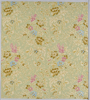 Dense Neo-Rococo pattern with two distinct roughly diamond-shaped motifs of flowers with stems and leaves repeated in interlocking vertical columns; Brown, bright blue, and pink flowers in many varieties; brown stems and leaves; ground is pale green; printed simulated tapestry weave texture.