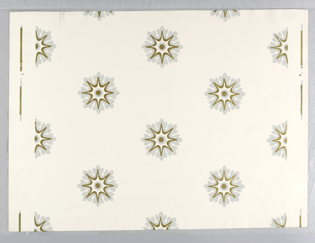 White ground. Rows of drop-repeating, star-centered, gray and gold foliate medallions.
