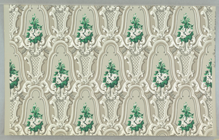 "On gray ground, ornate shaded scrollwork in shades of gray and white forming small cartouches enframing bouquets of white roses with bright green leaves. Printed in margin: ""Scalamandre Wallpaper""."