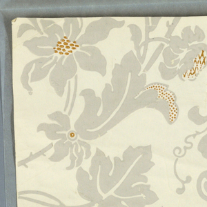 Against a white ground is printed a large, serpentine floral design with blossoms and foliage in light gray. Small, geometric details are printed in yellow ochre.