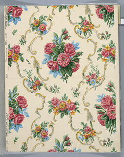 Design of sprays and bunches of roses, with scrolls forming oval shapes printed in pink, blue, green, and yellow on white ground.