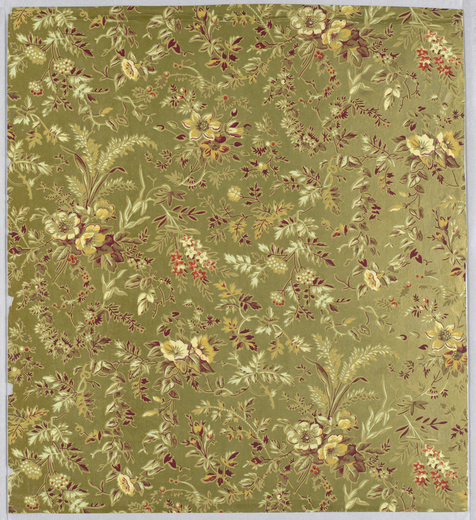Aesthetic all-over pattern of scattered bunches of flowers and leafy vines and branches; large diamond-shaped repeat in off-set column; crude block-printing affect with attempts at naturalistic shading; color scheme of tan overlaid with white, dark-red, yellow, and bright-red highlighting; metallic gold ground.