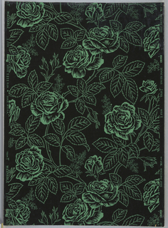 All-over pattern of vining rose bushes, printed in green outline on black ground.