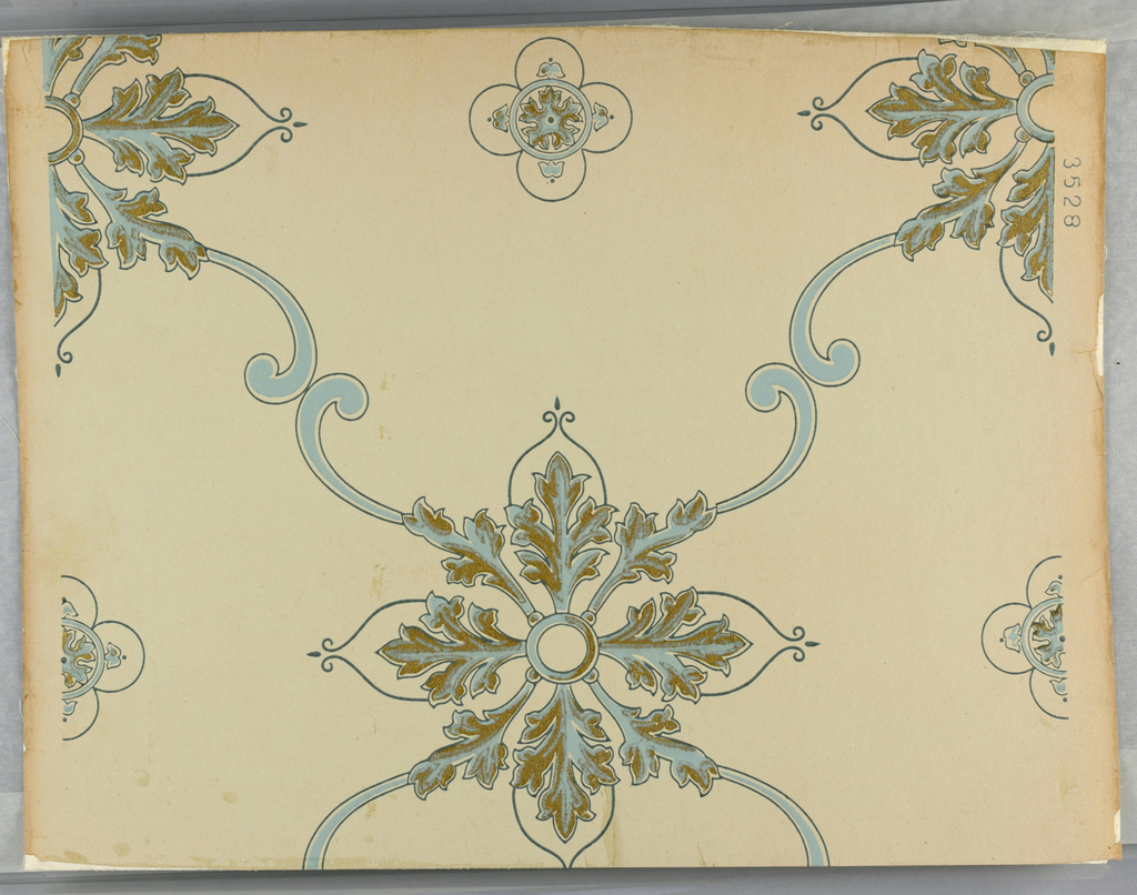 "Medallions formed of acanthus-like leafs, printed in gold and blue, with medallions joined by blue C-scrolls, printed on cream ground. Pattern number ""3528"" printed in selvedge."