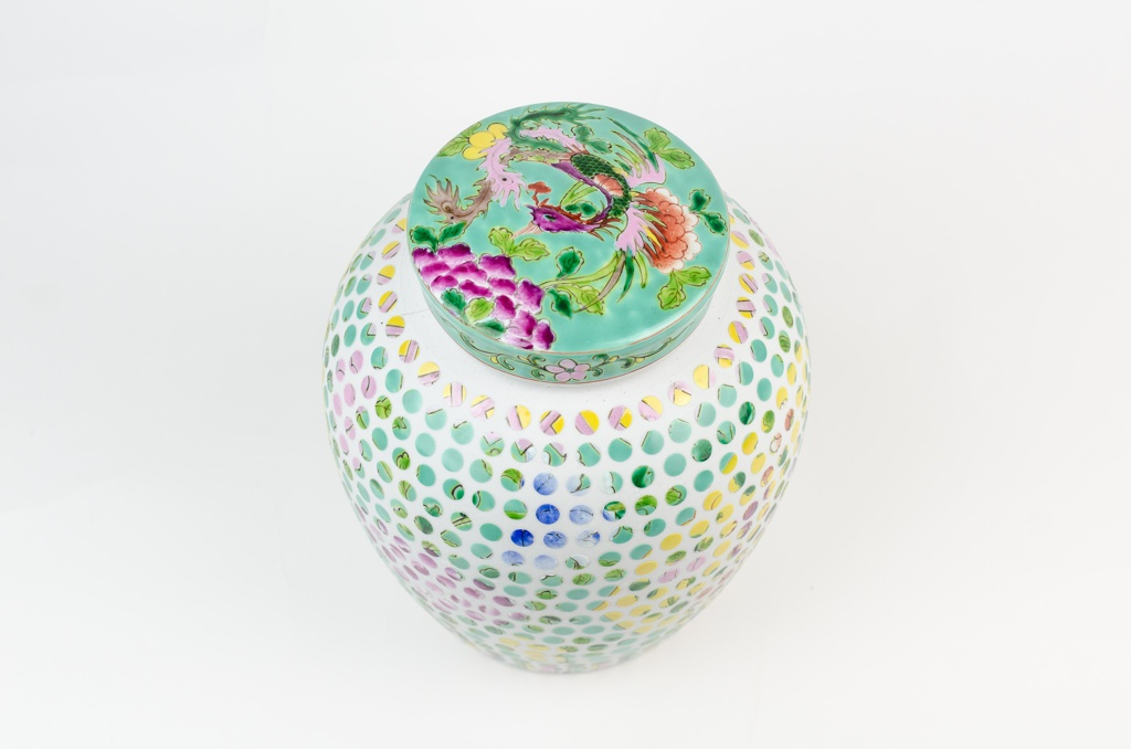 Ovoid vessel showing dotted geometric pattern with cover showing original floral decoration