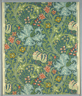 Lillies with fleur-de-lis petals and foliage arabesque. The flowers have faint floral patterns on them as well. Printed in green, red, blue and yellow on cream ground.
