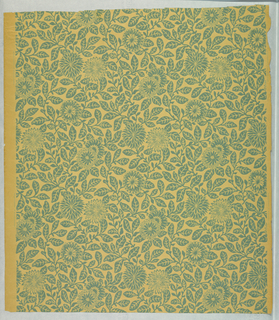 Small-scale pattern of chrysanthemums and foliage printed in one flat tone of green-blue.