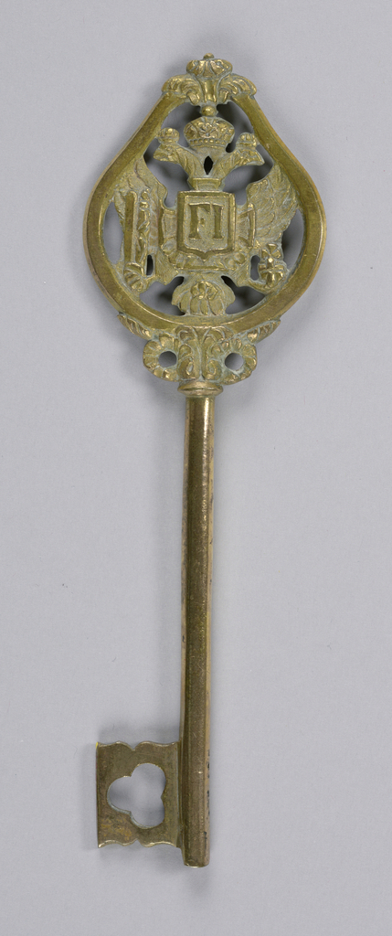 Bow in shape of hanging pear, supported by blossoms and leaves; contains worked a jour the Imperial eagle with the monogram F I (Francis I) in a shield on a cross, which is, below, surronded by the chain of the Golden Fleece.