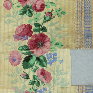 Stripes of small geometrical forms printed in blue, dotted in red, flanking wide central panel set with large vine of roses and forget-me-nots in natural colors, and foliate forms in green.