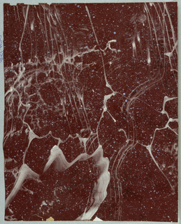 Marbleized with white veining and pale blue spatter on dark red ground.